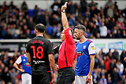 Referee Stephen Martin shows the red card to Bolton's Marc Wilson (18) during the EFL Sky Bet Championship match between Ipswich Town and Bolton Wanderers at Portman Road, Ipswich, England on 22 September 2018.