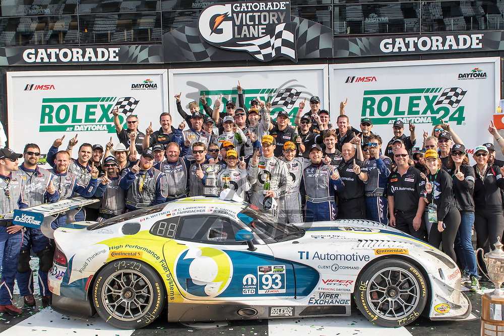Daytona Beach, FL - Jan 25, 2015:  The Riley Motorsports Dodge Viper SRT crew celebrate after winning the Rolex 24 at Daytona International Speedway in Daytona Beach, FL.