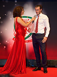 CARDIFF, WALES - Monday, October 5, 2015: Wales' Gareth Bale is interviewed by Frances Donovan after winning the Player of the Year Award during the FAW Awards Dinner at Cardiff City Hall. (Pic by David Rawcliffe/Propaganda)