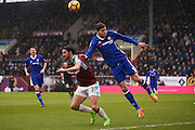 Burnley midfielder George Boyd (21) chases the ball as Chelsea defender Marcos Alonso (3) clears the danger with his head during the Premier League match between Burnley and Chelsea at Turf Moor, Burnley, England on 12 February 2017. Photo by Simon Davies.