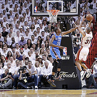 21 June 2012: Miami Heat small forward Shane Battier (31) takes a jumpshot over Oklahoma City Thunder small forward Kevin Durant (35)  during the Miami Heat 121-106 victory over the Oklahoma City Thunder, in Game 5 of the 2012 NBA Finals, at the AmericanAirlinesArena, Miami, Florida, USA. The Miami Heat wins the series 4-1.
