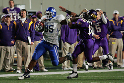Kentucky defensive lineman Ventrell Jenkins runs back 56 yard fumble recovery in the fourth quarter while showing the stiff arm to East Carolina quarterback Patrick Pinkney en route to the end zone. <br /> <br /> The University of Kentucky played East Carolina in the 2008 Liberty Bowl in Memphis, Tn. Kentucky won the game 25-19.
