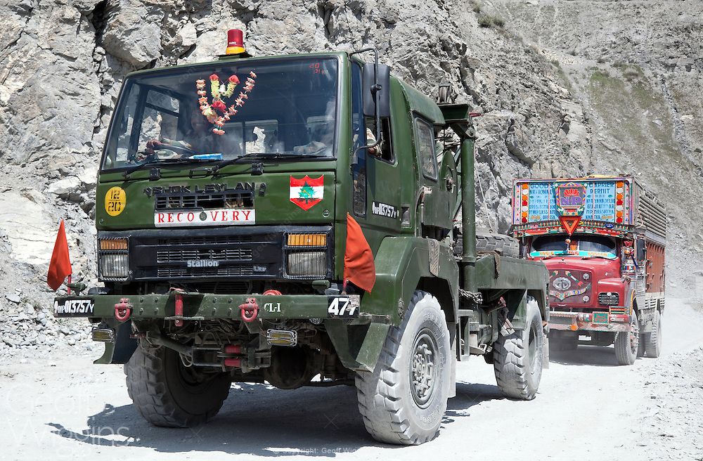 Indian Ashok Leyland heavy recovery truck towing broken down civilian vehicle in the treacherous Himalayan Zoji La pass on the road to Srinagar, Kashmir, Northern India