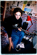 Bass player james, from band Deadfall, in his bedroom.<br /> Middlesbrough, 1995
