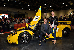 © Licensed to London News Pictures. 18/02/2016. JENSEN BUTTON and JODIE KIDD pose with a  MACLAREN F1 car at the launch of the London Classic Car Show.  The four day event brings together classic car owner, dealers, collectors, experts and enthusiasts. London, UK. Photo credit: Ray Tang/LNP
