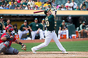 Oakland Athletics center fielder Mark Canha (20) bats against the Los Angeles Angels at Oakland Coliseum in Oakland, California, on September 6, 2017. (Stan Olszewski/Special to S.F. Examiner)
