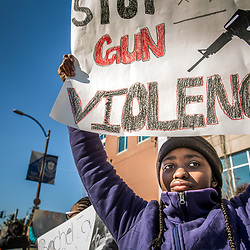 """Camille White said """"peacefullness and positivity"""" are needed to stop gun violence. She and other students from Camille White said """"peaceful and positivity"""" are needed to stop gun violence. She and other students from Cardinal Ritter College Preparatory High School marched in Midtown against gun violence March 14. (Photo by Lisa Johnston 