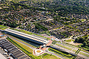 Nederland, Zuid-Holland, Barendrecht, 15-07-2012;  Overkapping Barendrecht, constructie gebouwd over 9 spoorlijnen, waaronder HSL en Betuweroute, om geluidsoverlast tegen te gaan. Het station maakt deel uit van de overkapping, verder zijn er op het dak een parkeerterrein en vlinderpark aangelegd. . The railway station is part of the covering-over of the HST in Barendrecht (SW Netherlands). Roof landscape has a parking lot and a butterfly garden...luchtfoto (toeslag), aerial photo (additional fee required).foto/photo Siebe Swart