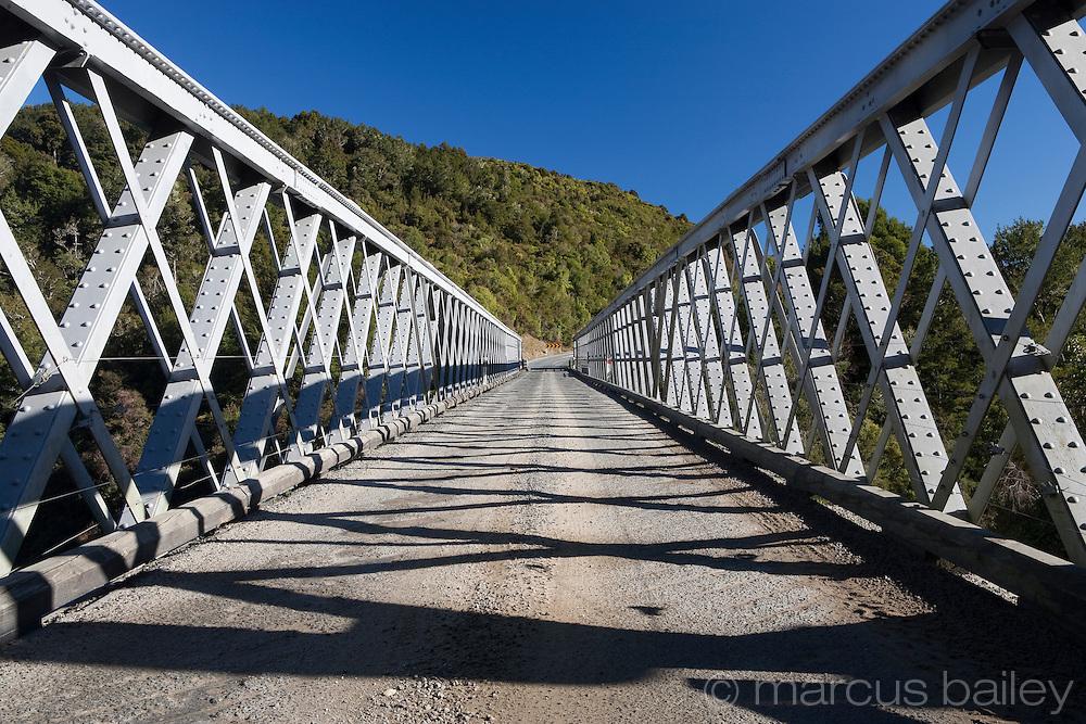 one lane bridge spanning the buller river, west coast, new zealand