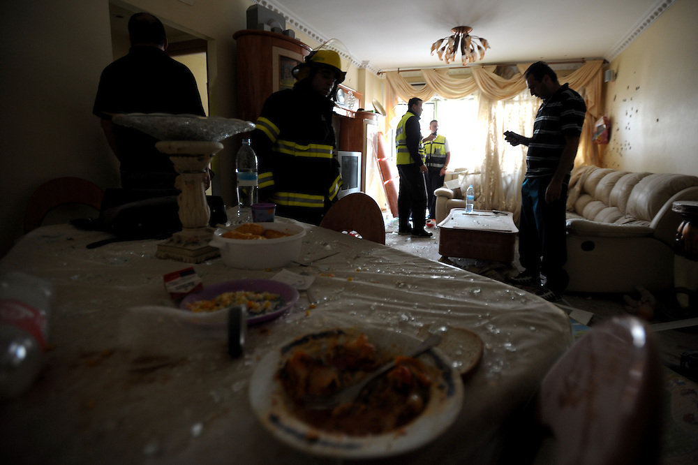 Ashdod, Israel - November 17, 2012: The remainings of a meal are laid on the table in the dining room, in an appartment that was hit by a rocket fired from Gaza Strip, at the fourth day of Operation Pillar of Defense. Photo by Gili Yaari  - Israel Photojournalist