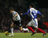 Photo: Lee Earle.<br /> Portsmouth v Chelsea. The Barclays Premiership.<br /> 26/11/2005. Chelsea's Jole Cole (L) gets away from Richard Hughes.