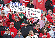 """November 06 2010: Nebraska fans hold up signs that read """"Big Ten Bound"""" and """"Always Bone Crushing"""" during the second half of the NCAA football game between the Nebraska Cornhuskers and the Iowa State Cyclones at Jack Trice Stadium in Ames, Iowa on Saturday November 6, 2010. Nebraska defeated Iowa State 31-30."""