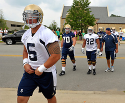 Aug. 7, 2010; Te'o arrives at the first training camp practie with a new coaching staff--and a new tattoo.