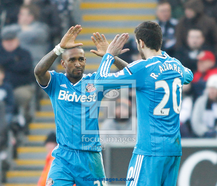 Jermain Defoe (L) celebrates the first goal for Sunderland during the Barclays Premier League match at the Liberty Stadium, Swansea<br /> Picture by Mike Griffiths/Focus Images Ltd +44 7766 223933<br /> 07/02/2015