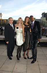 Left to right, Musician NICK RHODES, Model MEREDITH OSTROM and Fashion designer OZWALD BOATENG and his wife GYUNEL at the Fortune Forum Dinner held at Old Billingsgate, 1 Old Billingsgate Walk, 16 Lower Thames Street, London EC3R 6DX<br />