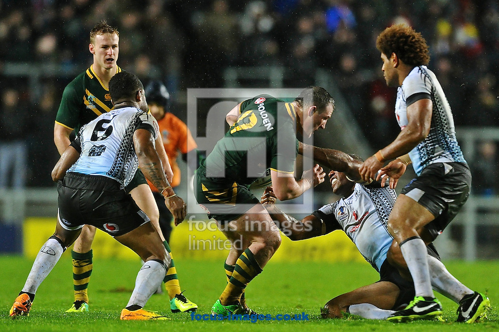 Picture by Ian Wadkins/Focus Images Ltd +44 7877 568959<br /> 02/11/2013<br /> Paul Gallen of Australia is tackled during the Rugby League World Cup 2013 match at Langtree Park , St Helens.