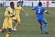 Scarborough Athletic, Adam Bolder (10) ands Glossop North End  Mohamud Ali (3) during the Evo-Stik Premier League match between Glossop North End and Scarborough Athletic at the Arthur Goldthorpe Stadium, Glossop, United Kingdom on 26 November 2016. Photo by Mark Pollitt.