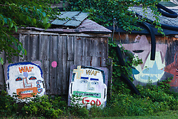 Painted plywood of war, and God.  Heidelberg Project, Detroit, Michigan.  The Heidelberg Project is a grass roots project started by artist Tyree Guyton that uses art to help revitalize the embattled neighborhood.  Each year, over 275,000 people visit the project .  For more information, go to www.heidelberg.org