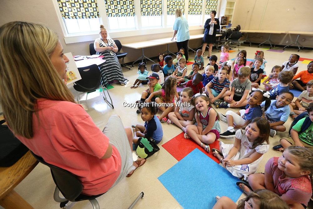 Cathryn Richey has a classroom full of rising kindergartners while she reads the book The Night Before Kindergarten as they prepare the children for their first day of school which is only a few weeks away.