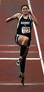 05/13/2009 - Madison's Arianna Supplee (173) painfully extends up on a bad knee while attempting to compete in the women's triple jump. The 5A PIL Varsity District Track Meet takes place at Lewis and Clark College....KEYWORDS:  City, Portland, high school, girls, boys, run, field, sports