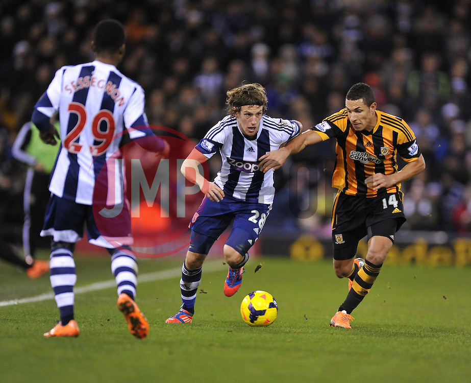 West Bromwich Albion's Billy Jones attacks down the wing under pressure from Hull City's Jake Livermore - Photo mandatory by-line: Alex James/JMP - Tel: Mobile: 07966 386802 21/12/2013 - SPORT - FOOTBALL - The Hawthorns - West Bromwich - West Brom v Hull City - Barclays Premier League