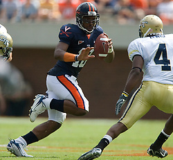 Virginia quarterback Jameel Sewell (10) delivers a stiff arm to Georgia Tech safety Jamal Lewis (4)..The Virginia Cavaliers football team faced the Georgia Tech Yellow Jackets at Scott Stadium in Charlottesville, VA on September 22, 2007.
