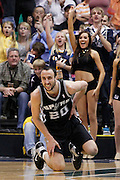 Spurs guard Manu Ginobili of Argentina looks down the court after falling during an NBA basketball game against the Jazz in Salt Lake City, Wednesday Jan. 26, 2011. (AP Photo/Colin E Braley)