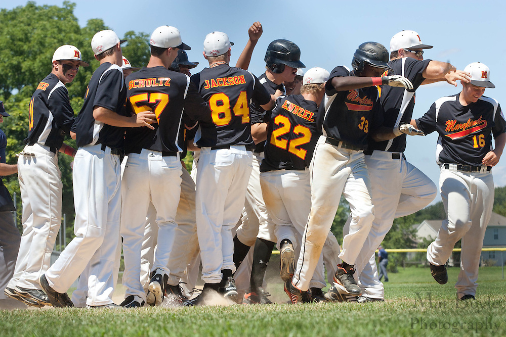 The Maryland teams swarms Maryland's Taylor Slaghenhought after hitting a two run home run in the 2nd inning during the winner take all final of the Eastern Regional Senior League tournament between Pennsylvania and Maryland held in West Deptford on Thursday, August 11.