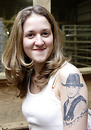 "Heather Beverly, from Lebanon, shows her tattoo ""in Memory of my Brother,"" who died in December of 2006."