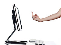 communication between human hand and a computer display monitor on isolated white background expressing obscene gesture concept