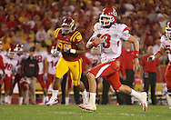 October 9 2010: Utah Utes quarterback Jordan Wynn (3) scrambles with the ball during the first half of the NCAA football game between the Utah Utes and the Iowa State Cyclones at Jack Trice Stadium in Ames, Iowa on Saturday October 9, 2010. Utah defeated Iowa State 68-27.