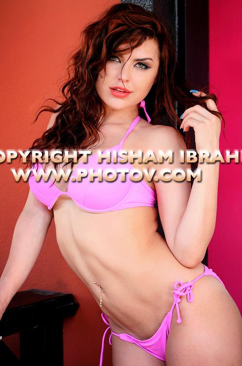 Sexy young Russian woman in purple bikini, Freepost, Bahamas.