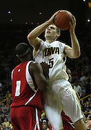 21 JANUARY 2009: Iowa's Matt Gatens (5) puts up a shot over Wisconsin's Marcus Landry (1) during the first half of an NCAA college basketball game Wednesday, Jan. 21, 2009, at Carver-Hawkeye Arena in Iowa City, Iowa. Iowa defeated Wisconsin 73-69 in overtime.