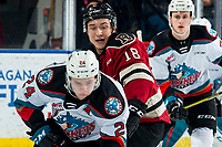 KELOWNA, BC - FEBRUARY 15: Jace Isley #18 of the Red Deer Rebels checks Kyle Topping #24 of the Kelowna Rockets at Prospera Place on February 15, 2020 in Kelowna, Canada. (Photo by Marissa Baecker/Shoot the Breeze)