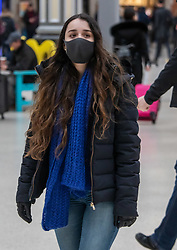 © Licensed to London News Pictures. 28/02/2020. London, UK. A Passengers at Victoria Station, London wears a protective mask as fears of a pandemic increase after six cases of Coronavirus are confirmed in the UK in the last 24 hours . Photo credit: Alex Lentati/LNP