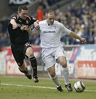 Photo: Aidan Ellis.<br /> Bolton Wanderers v Sunderland. The Barclays Premiership. 18/03/2006.<br /> Bolton's Henrik Pedersen holds off Sunderland's Tommy Miller