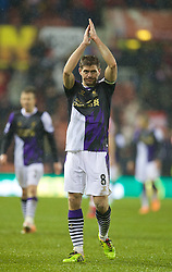 STOKE-ON-TRENT, ENGLAND - Sunday, January 12, 2014: Liverpool's captain Steven Gerrard applauds the travelling supporters after his side's 5-3 victory over Stoke City during the Premiership match at the Britannia Stadium. (Pic by David Rawcliffe/Propaganda)