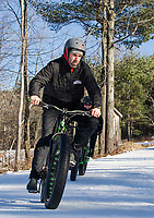 "Kale Poland leads a ""lunch hour"" workout with Sonya Misiaszek at Gunstock Nordic on Thursday afternoon.  (Karen Bobotas/for the Laconia Daily Sun)"