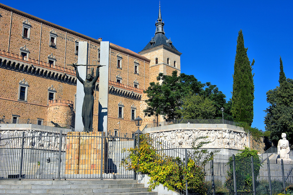Siege of Alc&aacute;zar Monument in Toledo, Spain<br /> In July of 1936, during the initial days of the Spanish Civil War, a Republican force of 8,000 men began attacking the 1,000, ill-equipped Nationalists inside of Toledo&rsquo;s Alc&aacute;zar. The brutal Siege of Alc&aacute;zar lasted 70 days, leaving most of the fortress destroyed. Yet Colonel Jos&eacute; Moscard&oacute; Ituarte refused to surrender even when his 16 year old son was about to be executed. The Nationalists eventually won when General Franco&rsquo;s reinforcements arrived. A tribute to this heroic event was erected next to the Alc&aacute;zar in 1961. The sculptor was Juan de Avalos.