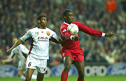 LIVERPOOL, ENGLAND - Tuesday, March 19, 2002: Liverpool's Emile Heskey and AS Roma's Aldair during the UEFA Champions League Group B match at Anfield. (Pic by David Rawcliffe/Propaganda)