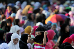 QUEZON , Sept. 12, 2016 (Xinhua) -- A Muslim girl fixes her hijab before a prayer in celebration of the Eid al-Adha in Quezon City, the Philippines, Sept. 12, 2016. Muslims across the world celebrate the Eid al-Adha festival, or the Festival of Sacrifice, in commemoration of Prophet Abraham's readiness to sacrifice his son to show obedience to God. (Xinhua/Rouelle Umali).****Authorized by ytfs* (Credit Image: © Rouelle Umali/Xinhua via ZUMA Wire)