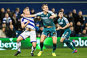 Wigan Athletic defender Reece Burke (32), Queens Park Rangers defender Jake Bidwell (3) during the EFL Sky Bet Championship match between Queens Park Rangers and Wigan Athletic at the Loftus Road Stadium, London, England on 21 February 2017. Photo by Sebastian Frej.