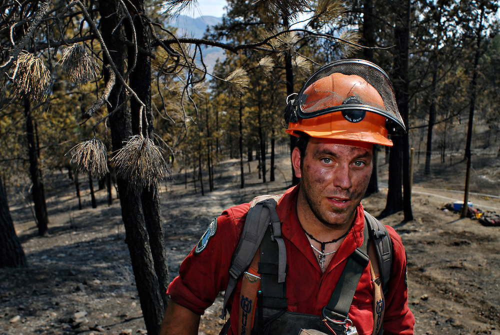 WEST KELOWNA, BC - 20/07/09 -  An exhausted Kyle Young, a firefighter from 100 Mile House, takes a break from fighting the 350 plus hectare Glenrosa fire on July 20.  Photo by Daniel Hayduk/ The Toronto Star