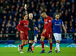 LIVERPOOL, ENGLAND - Sunday, March 3, 2019: Liverpool's Fabio Henrique Tavares 'Fabinho' is shown a yellow card by referee Martin Atkinson during the FA Premier League match between Everton FC and Liverpool FC, the 233rd Merseyside Derby, at Goodison Park. (Pic by Laura Malkin/Propaganda)