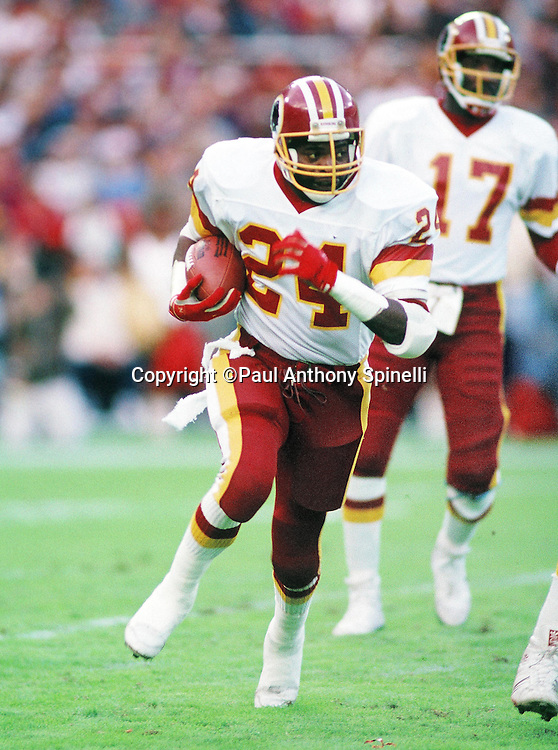 Washington Redskins running back Kelvin Bryant (24) runs the ball during the NFL football game against the New Orleans Saints on Nov. 6, 1988 in Washington, DC. The Redskins won the game 27-24. (©Paul Anthony Spinelli)