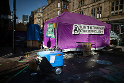 © Licensed to London News Pictures. 01/09/2019. Manchester, UK. A message posted to the side of a diesel generator , being used to power the event stage at the demonstration . Extinction Rebellion block roads around Deansgate in Manchester City Centre , during a third day of planned disruption organised by environmental campaigners . Manchester City Council has declared a climate emergency but activists say the council's development plans do not reflect this . Photo credit: Joel Goodman/LNP