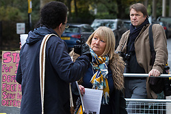 London, UK. 16 November, 2019. Andi Fox, Vice-Chair of the NEC, discusses freedom of movement with an activist from Movement for Justice as she arrives at Labour's Clause V meeting. The Clause V meeting, chaired by the party leader and attended by members of the National Executive Committee (NEC), relevant Shadow Cabinet members and members of the National Policy Forum, will finalise the party's general election manifesto. The meeting is named after Clause V of the Labour Party rulebook. Credit: Mark Kerrison/Alamy Live News