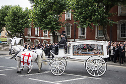 © Licensed to London News Pictures . 30/06/2017 . Stockport , UK . Martyn's coffin is taken from the Town Hall after the service . The funeral of Martyn Hett at Stockport Town Hall . Martyn Hett was 29 years old when he was one of 22 people killed on 22 May 2017 in a murderous terrorist bombing committed by Salman Abedi, after an Ariana Grande concert at the Manchester Arena . Photo credit : Joel Goodman/LNP
