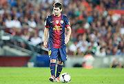 Lionel Messi prepares to take a free kick for Barcelona. His left ear is illumated by a green beam from a laser gun pointed at him by a fan in the stands.  Barcelona v Real Madrid, Supercopa first leg, Camp Nou, Barcelona, 23rd August 2012...Credit - Eoin Mundow/Cleva Media.