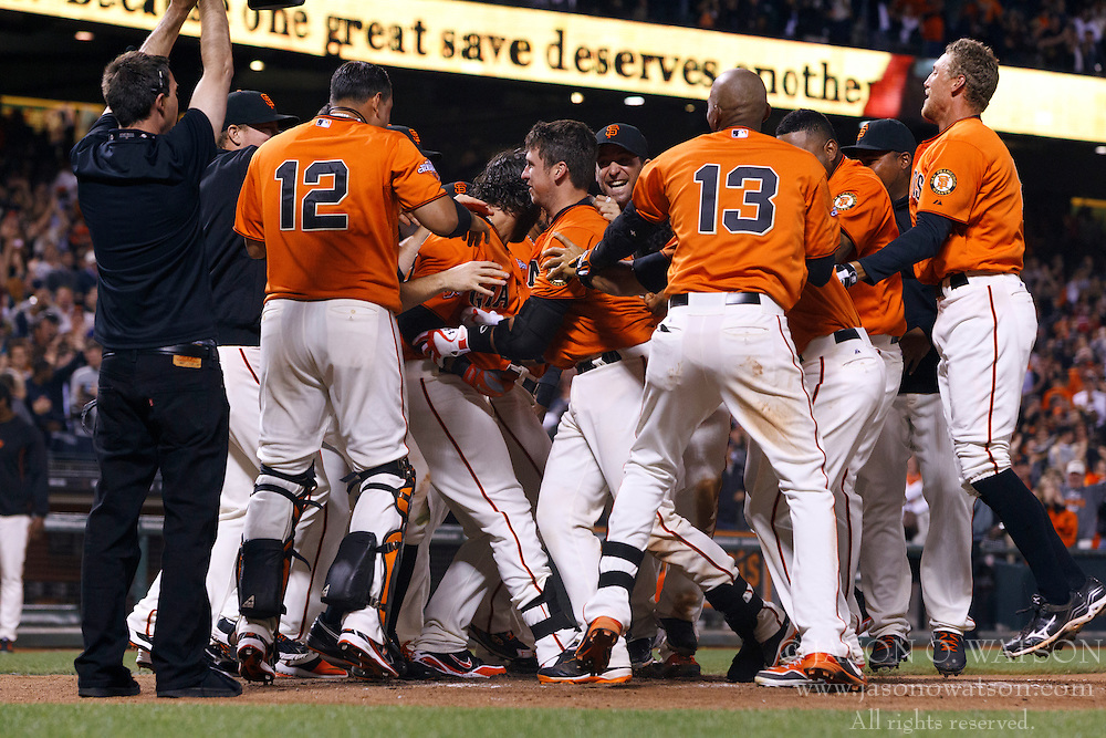 SAN FRANCISCO, CA - MAY 03: Buster Posey #28 of the San Francisco Giants (center) is congratulated by teammates at home plate after hitting a walk-off home run against the Los Angeles Dodgers during the ninth inning at AT&T Park on May 3, 2013 in San Francisco, California. The San Francisco Giants defeated the Los Angeles Dodgers 2-1. (Photo by Jason O. Watson/Getty Images) *** Local Caption *** Buster Posey